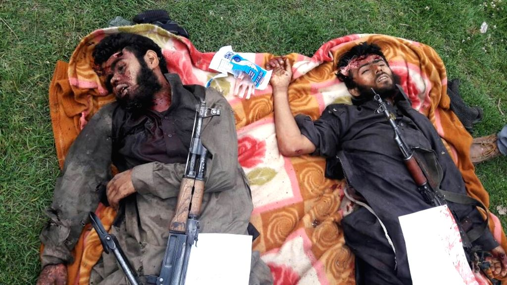 Bodies of the militants killed in a gunfight with security forces in Warpora of Jammu and Kashmir's Kupwara district on May 14, 2017.
