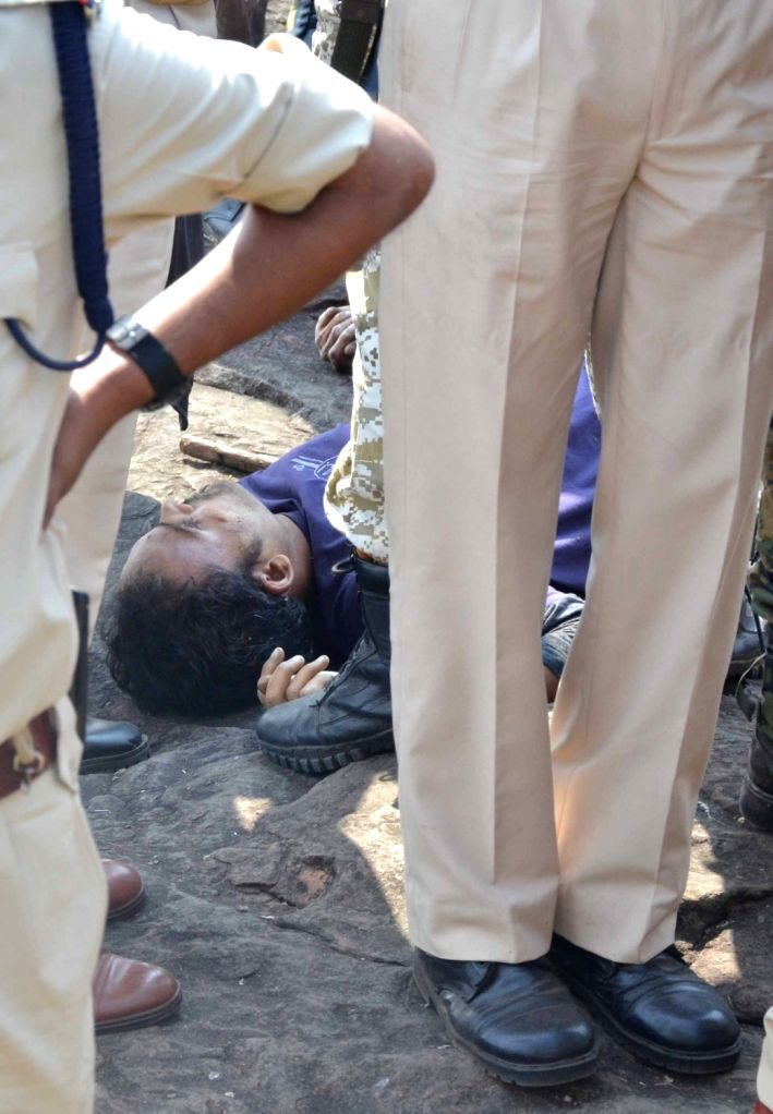 Body of one of the  eight terrorists of the banned Students Islamic Movement of India (SIMI) who escaped from Bhopal Central Jail and were killed in a gunfight with police on the outskirts of ...