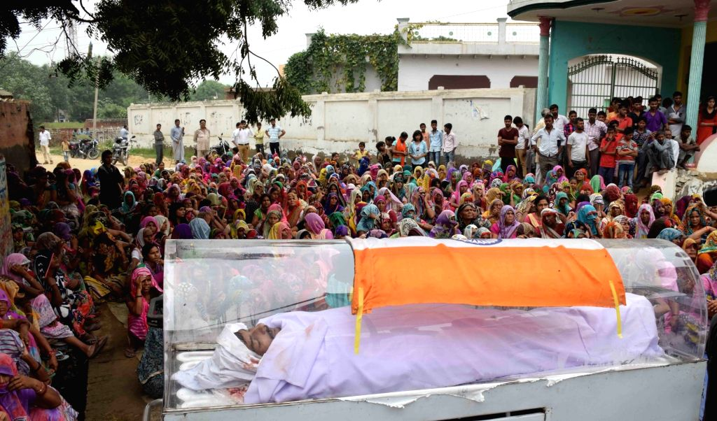 Body of Ravi Sisodia, one of the 19 people arrested in Akhlaq murder case at Bishahra village in Dadri, Uttar Pradesh on Oct 6, 2016. Sisodia's coffin was draped with the national flag and he ...