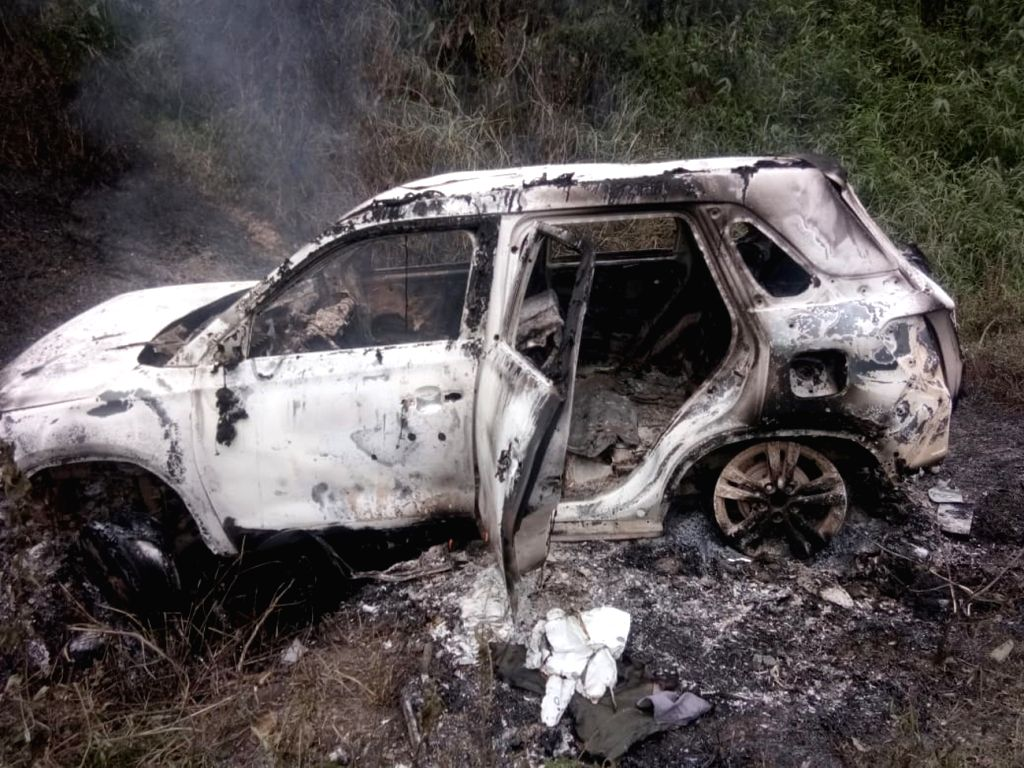 Bogapani: The charred remains of the car of National People's Party (NPP) MLA from Khonsa West constituency, Tirong Aboh, who along with ten others was killed in an ambush by suspected Naga militants on Tuesday at Bogapani in Tirap district of Arunac