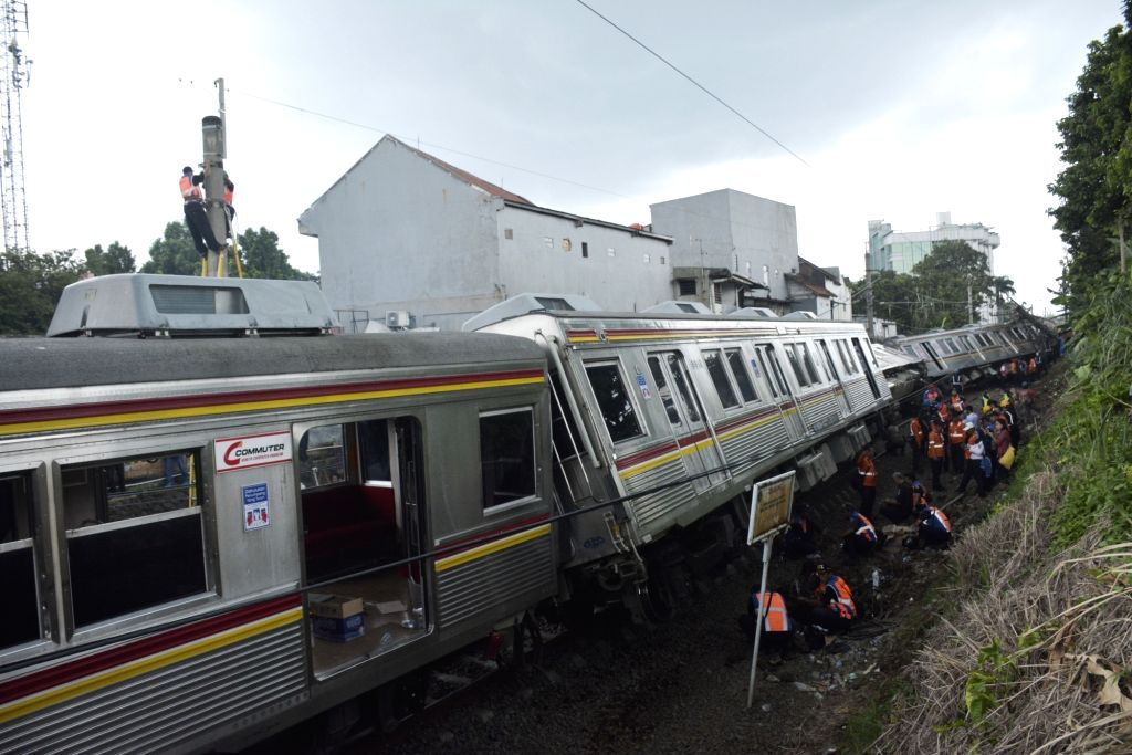 BOGOR, March 10, 2019 - Staff members from Kereta Commuter Indonesia (KCI) work at the scene after a commuter train derailed in Bogor district of West Java province, Indonesia, on March 10, 2019. At ...