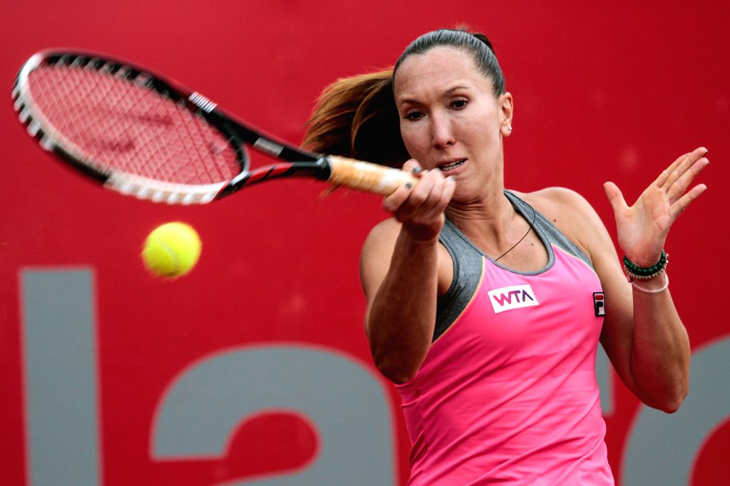 Jelena Jankovic of Serbia returns a hit to Lara Arruabarrena of Spain during their quarter-final match of the Claro Open Colsanitas of the Women's Tennis ...