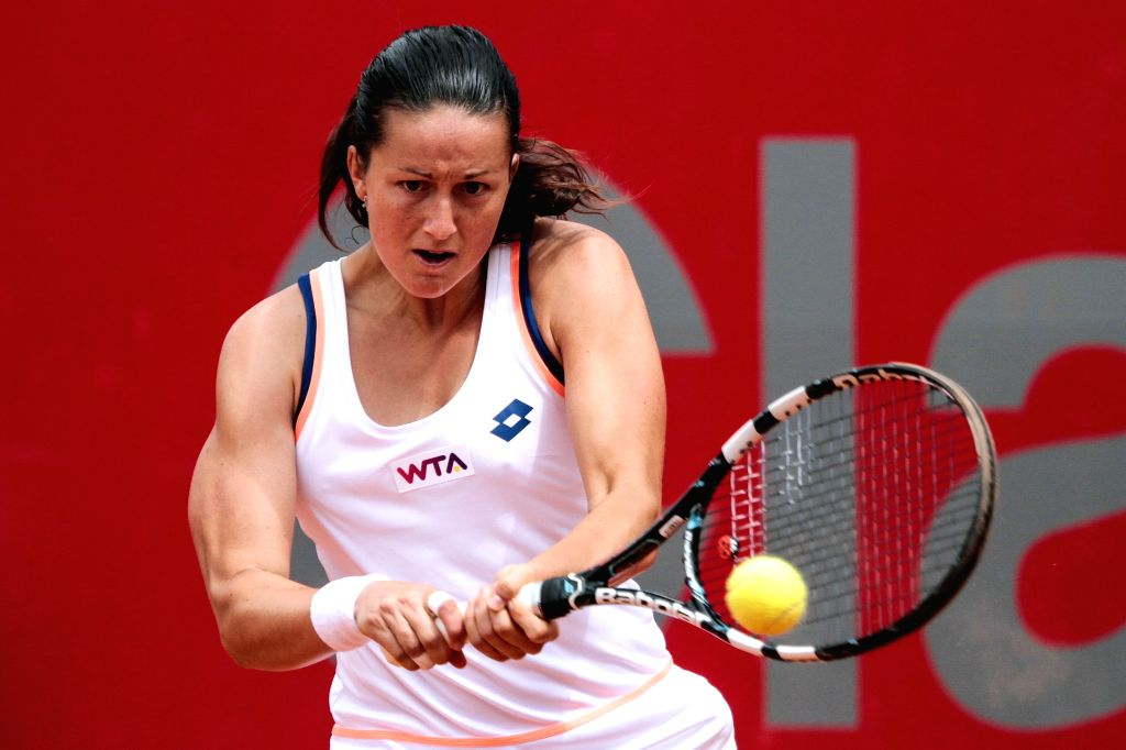 Lara Arruabarrena of Spain returns a hit to Jelena Jankovic of Serbia during their quarter-final match of the Claro Open Colsanitas of the Women's Tennis ...