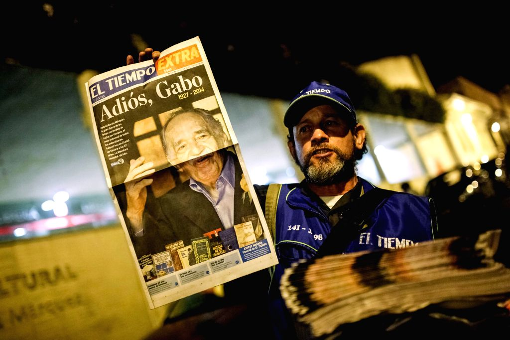 A man sells newspaper with news of the death of the Colombian writer and journalist Gabriel Garcia Marquez in Bogota, capital of Colombia, on April 17, 2014. ...