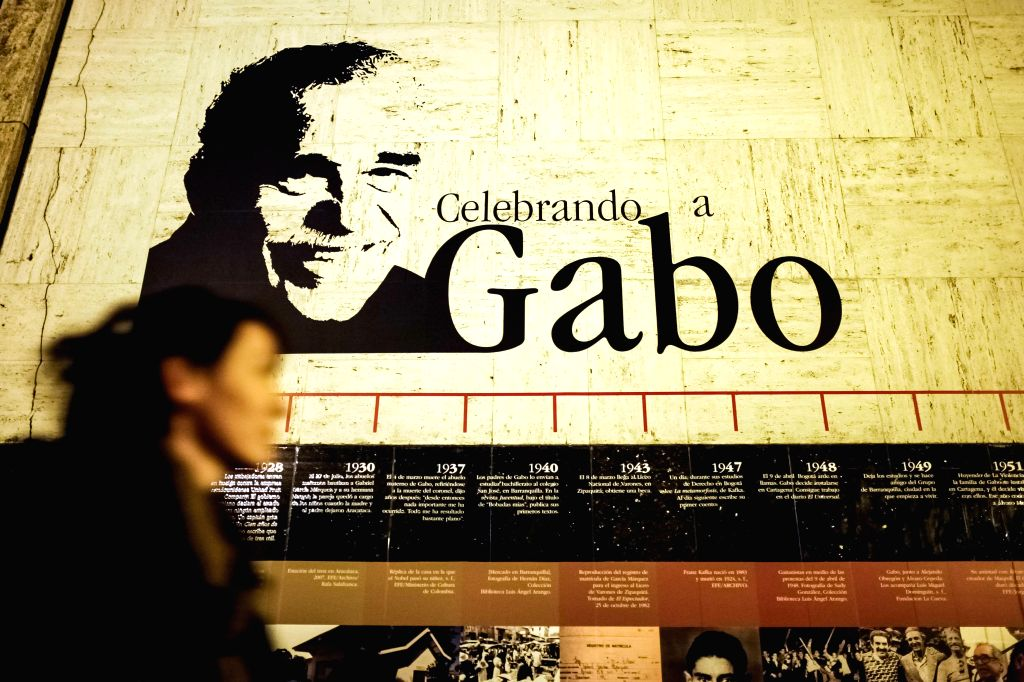 A woman passes by posters of the Colombian writer and journalist Gabriel Garcia Marquez's outside the Luis Angel Arango Library in Bogota, capital of Colombia, on ..