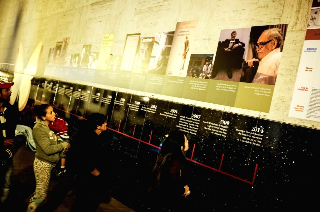 People look at an exhibition of the Colombian writer and journalist Gabriel Garcia Marquez's life outside the Luis Angel Arango Library in Bogota, capital of ...