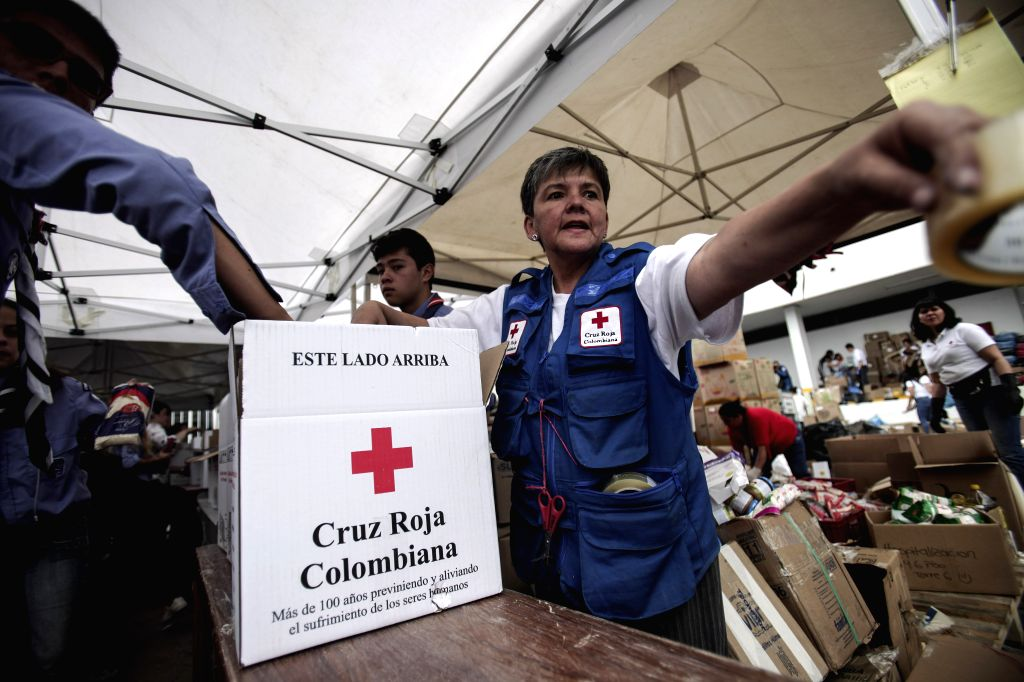 BOGOTA, April 9, 2017 - The coordinator of the reception and assembly of aid for the people affected by the landslide in Mocoa, Maria Rafaela Camargo, works at one of the Red Cross headquarters in ...