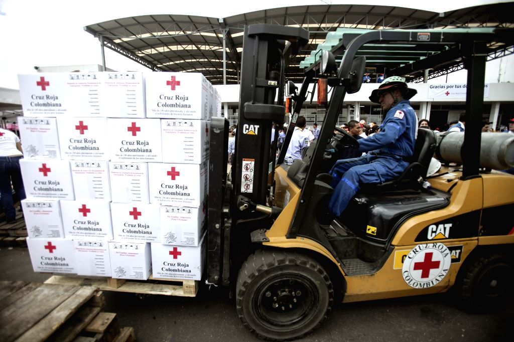 BOGOTA, April 9, 2017 - Volunteers receive aid for the people affected by the landslide in Mocoa, at one of the Red Cross headquarters in Bogota, capital of Colombia, on April 8, 2017. At least 306 ...