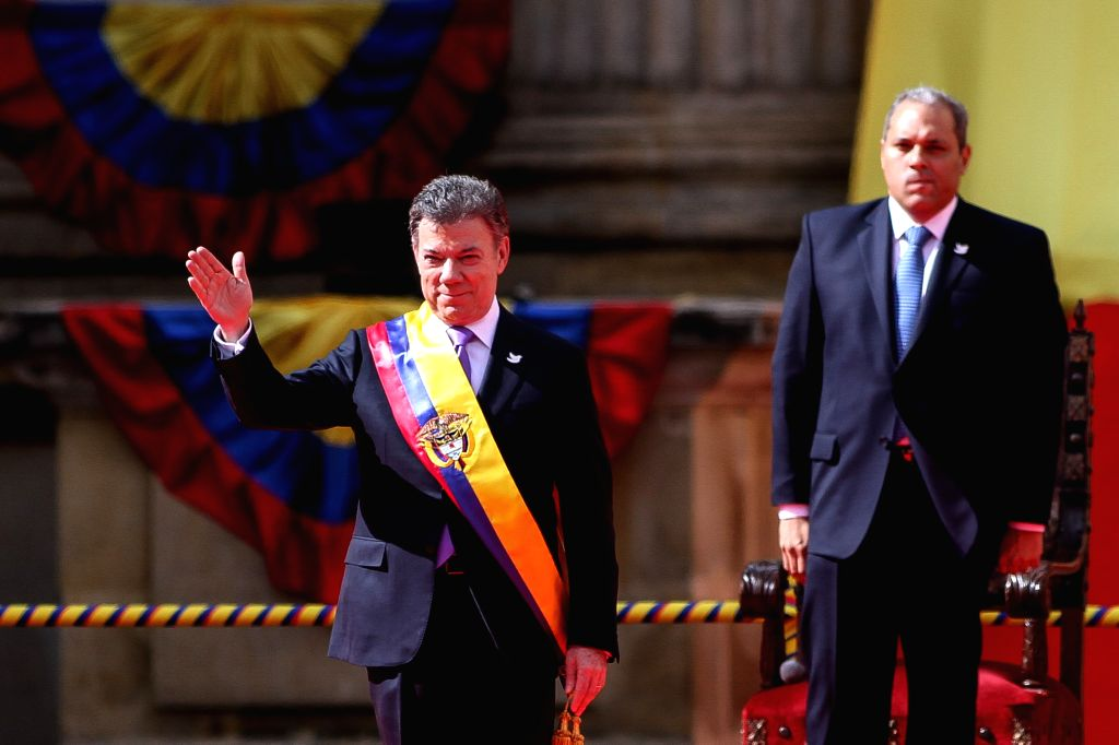 Colombian President Juan Manuel Santos (L) attends the swearing-in ceremony in Bogota, capital of Colombia, on Aug. 7, 2014. Santos was sworn in for a second term on .