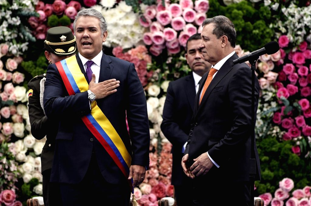 BOGOTA, Aug. 8, 2018 - Colombian President Ivan Duque (Front L) attends his swearing-in ceremony at Bolivar Square, in Bogota, capital of Colombia, on Aug. 7, 2018.