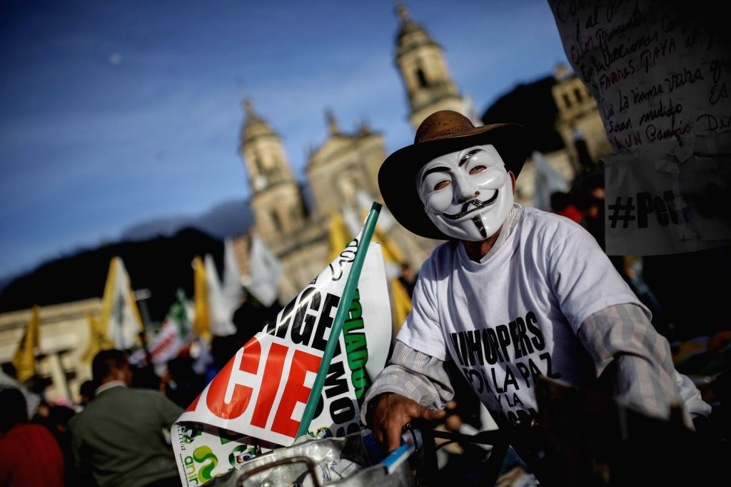 """A demonstrator participates in the """"March for Peace and Democracy"""" during the fifth day of protests against the destitution of Bogota's Mayor ..."""