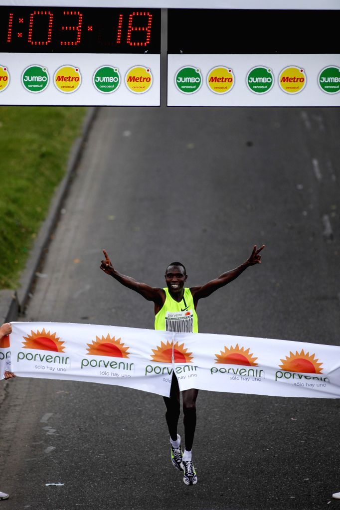 Kenynan athlete Geoffrey Kipsang Kamworor crosses the finishing line in the 15th edition of the Bogota Half Marathon, in the city of Bogota, capital of Colombia, on .