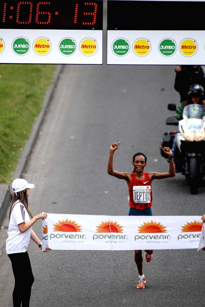Kenynan athlete Rita Jeptoo crosses the finishing line in the 15th edition of the Bogota Half Marathon, in the city of Bogota, capital of Colombia, on July 27, 2014.