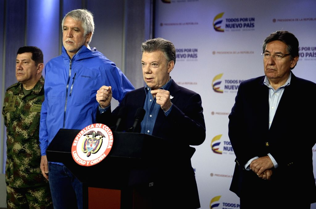 BOGOTA, June 19, 2017 - Image provided by Colombia's Presidency shows Juan Manuel Santos (2nd R) speaking on a press conference after the explosion at Andino Commercial Center in Bogota, capital of ...