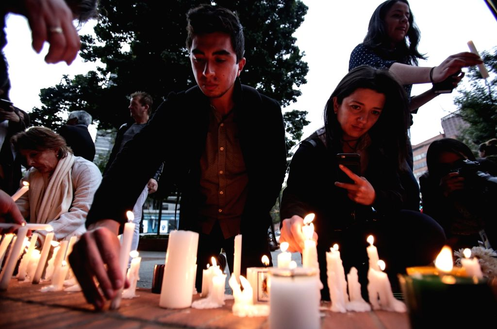 BOGOTA, June 19, 2017 - People light candles in tribute to the victims in the explosion at Andino Commercial Center in Bogota, capital of Colombia, on June 18, 2017. Three people were killed and nine ...