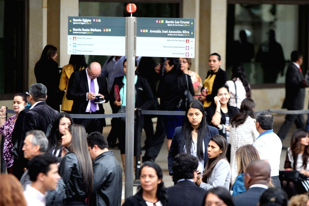 People gather outside a building after an earthquake of 6.2 magnitude in the city of Bogota, Colombia, on March 10, 2015. An earthquake measuring 6.2 on the Richter ...