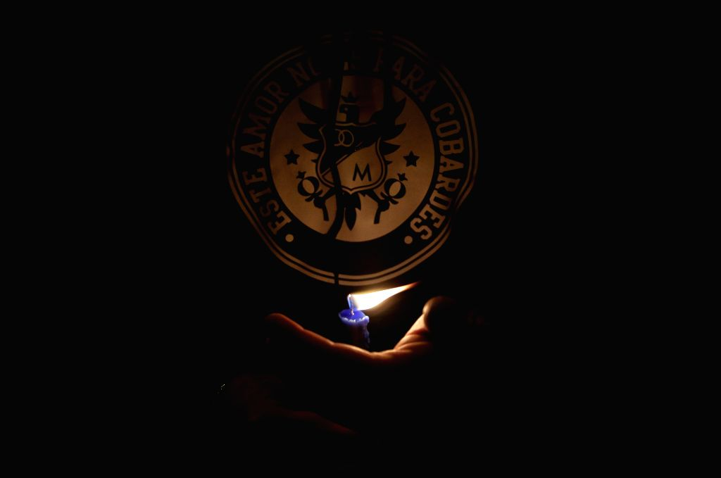 BOGOTA, Nov. 30, 2016 - A fan of the Colombian soccer team Millonarios observes a vigil for the victims of the Brazilian soccer team Chapecoense, in Bogota, Colombia, on Nov. 29, 2016. A charter ...
