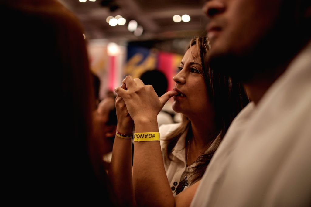 BOGOTA, Oct. 2, 2016 - A woman reacts during the ballot count of the plebiscite for the peace agreement signed by the Colombian government and the Armed Revolutionary Forces of Colombia (FARC), in ...