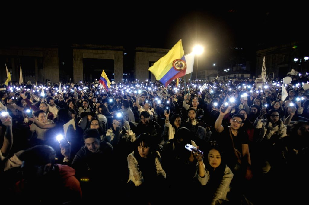 "BOGOTA, Oct. 21, 2016 - People take part in the ""March of the Light"", at Bolivar Square, in Bogota, Colombia, on Oct. 20, 2016. The ""March of the Light"" took place in support of ..."