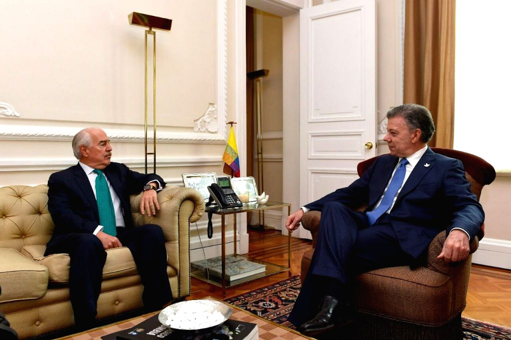 BOGOTA, Oct. 5, 2016 - Colombian President Juan Manuel Santos (R) meets with former Colombian president Andres Pastrana at the Narino Palace in Bogota, capital of Colombia, on Oct. 5, 2016. Santos ...