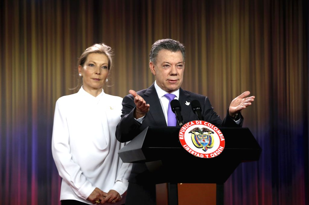 BOGOTA, Oct. 7, 2016 - Colombian President Juan Manuel Santos (R) delivers a statement after the announcement of being awarded with the 2016 Nobel Peace Prize, accompanied by his wife Maria Clemencia ...