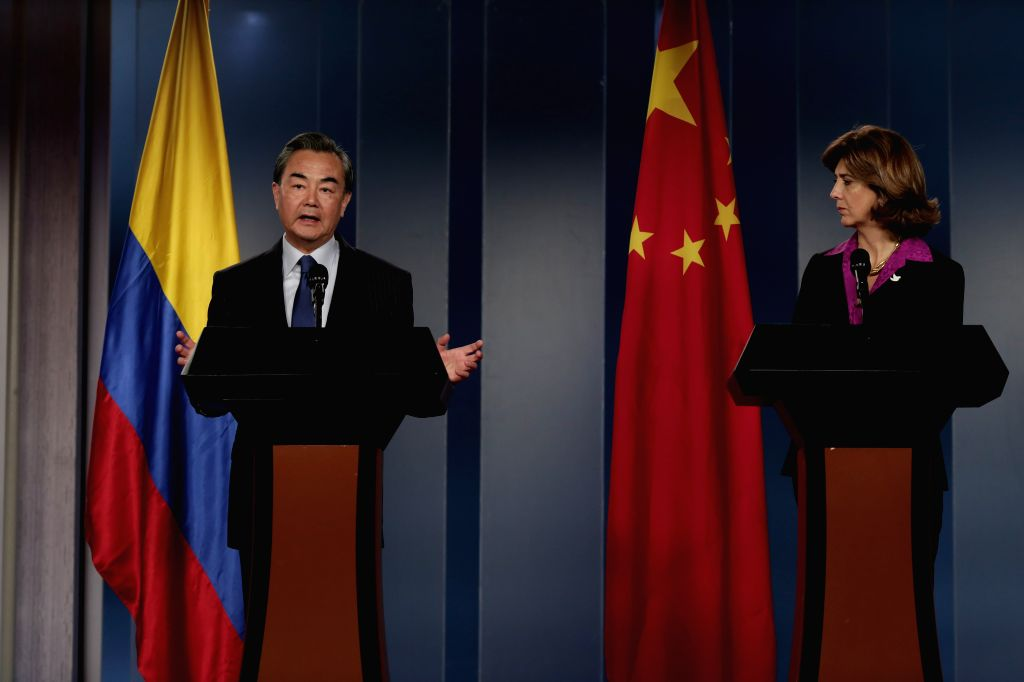 BOGOTA, Oct. 8, 2016 - Chinese Foreign Minister Wang Yi (L) and his Colombian counterpart Maria Angela Holguin Cuellar attend a press conference during his visit in Bogota, Colombia, Oct. 7, 2016. - Wang Y