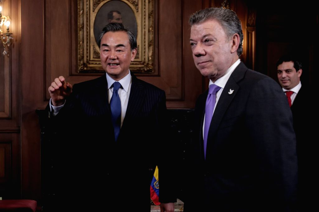 BOGOTA, Oct. 8, 2016 - Colombian President Juan Manuel Santos (R, front) meets with Chinese Foreign Minister Wang Yi (L) in Bogota, Colombia, Oct. 7, 2016. - Wang Y
