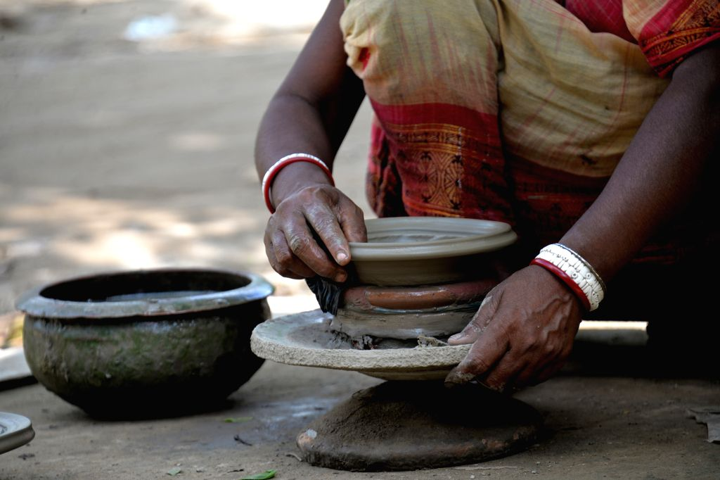 BOGRA, July 2, 2017 - A potter makes pottery on wheel at a village in Bangladesh's Bogra district, some 197 km northwest of Dhaka, on June 28, 2017.