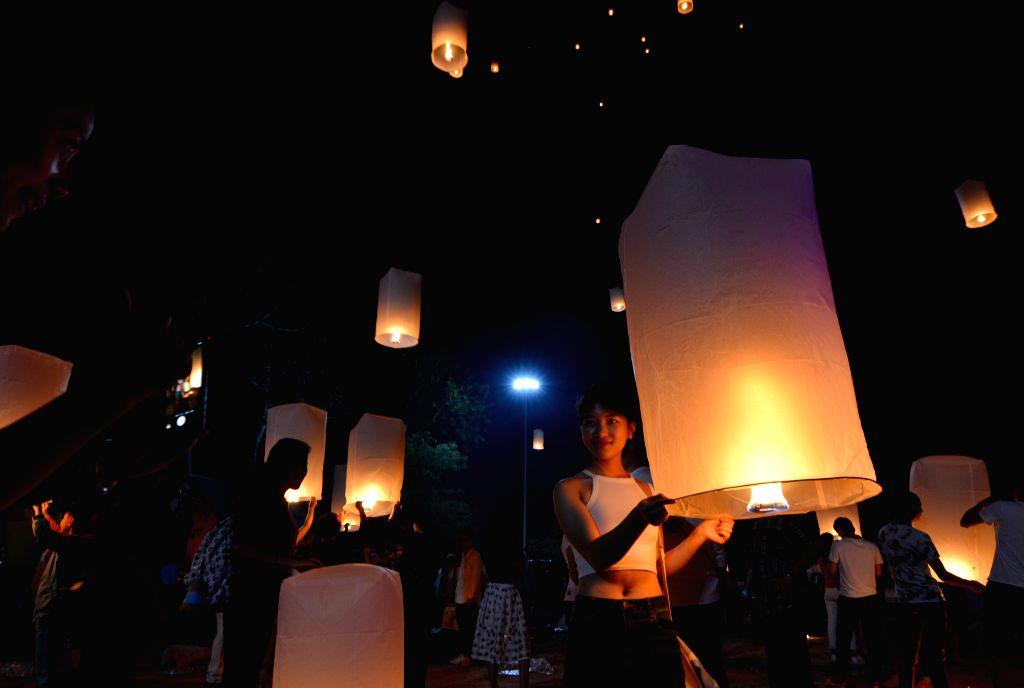 BOKEO, Jan. 28, 2018 - People fly lanterns during the Kapok festival in Bokeo province, Laos, Jan. 27, 2018.