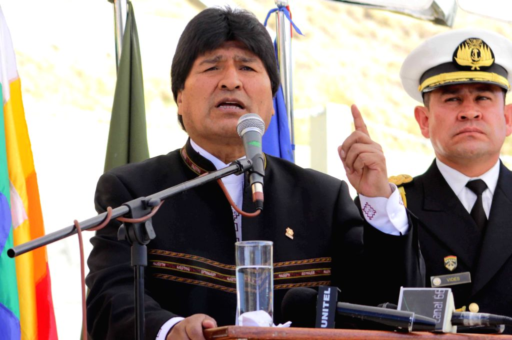 Bolivian President Evo Morales (L) delivers a speech during a special event for 28th anniversary of the founding of the Special Force of Fight Against Drug ...
