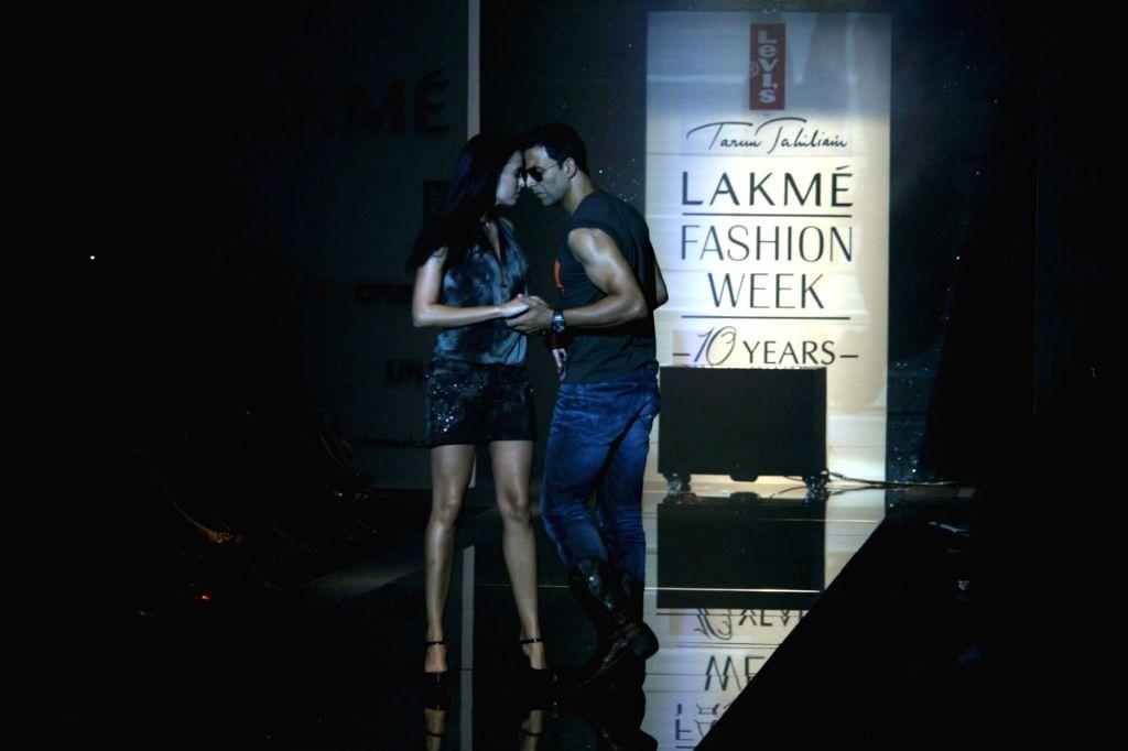 Bollywood actor Akshay Kumar walks the ramp for fashion designer Tarun Tahiliani's at the ongoing autumn/winter edition of Lakme India Fashion Week in Mumbai.