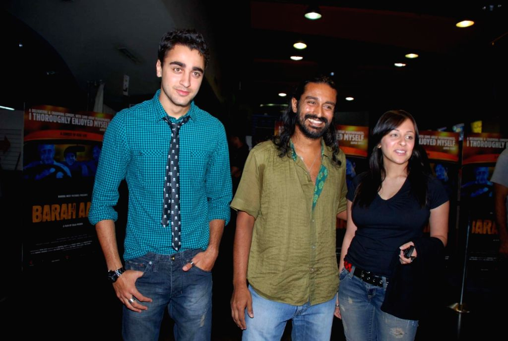 """Bollywood actor Imran Khan and his girlfriend Avantika with a friend at a private screening of fothcoming film """"Barah Anna"""" at Fame Adlabs in Mumbai Friday night. The film is releasing March"""