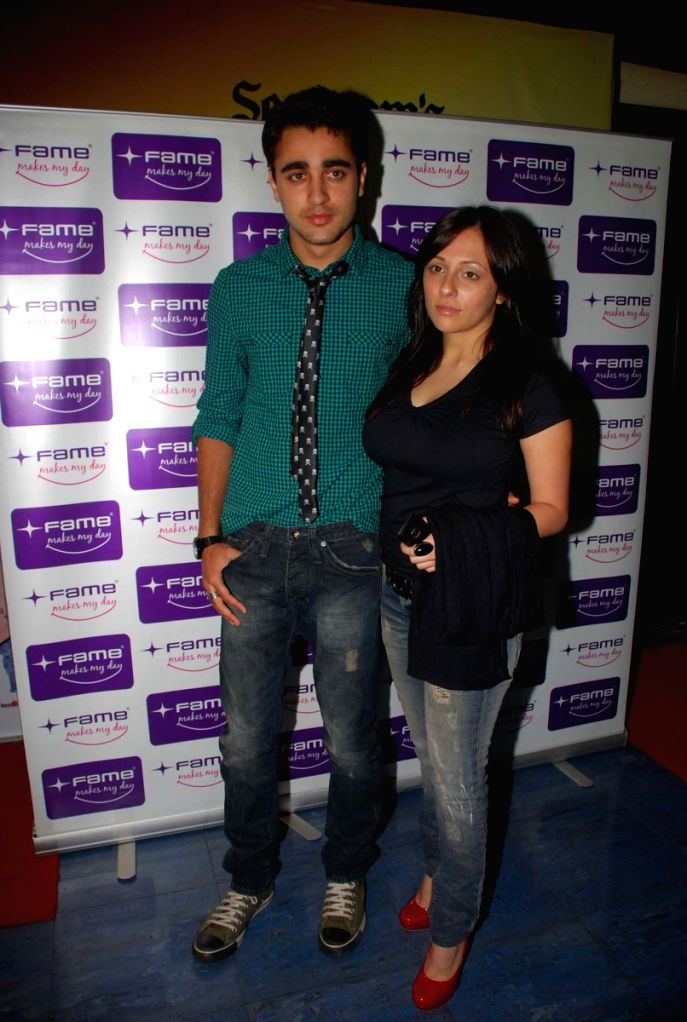 """Bollywood actor Imran Khan and his girlfriend Avantika at a private screening of forthcoming film """"Barah Anna"""" at Fame Adlabs in Mumbai Friday night. The film is releasing March 20."""