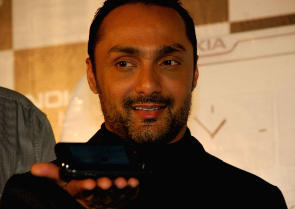 "Bollywood actor Rahul Bose prebooks his mobile device ""Nokia N97"" at a function in Kolkata on Tuesday 16th June 2009."