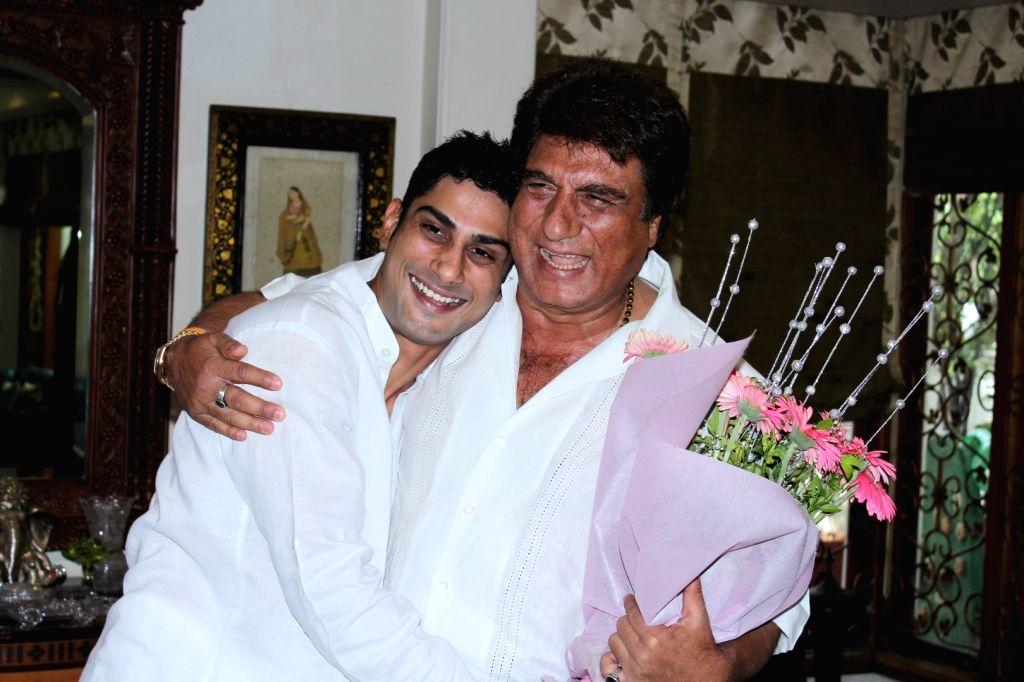 Bollywood actor Raj Babbar celebrates his 65th birthday with his son Prateik Babbar in Mumbai, on June 23, 2017. - Raj Babbar and Prateik Babbar