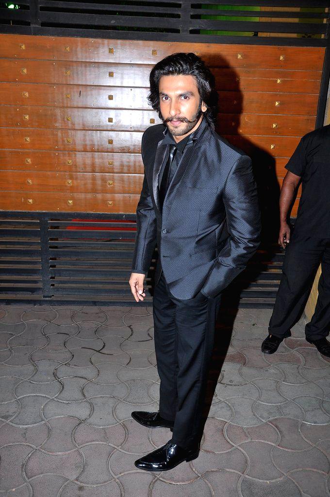 Bollywood actor Ranveer Singh arrives at the red carpet of The Filmfare Awards 2013 in Mumbai. - Ranveer Singh