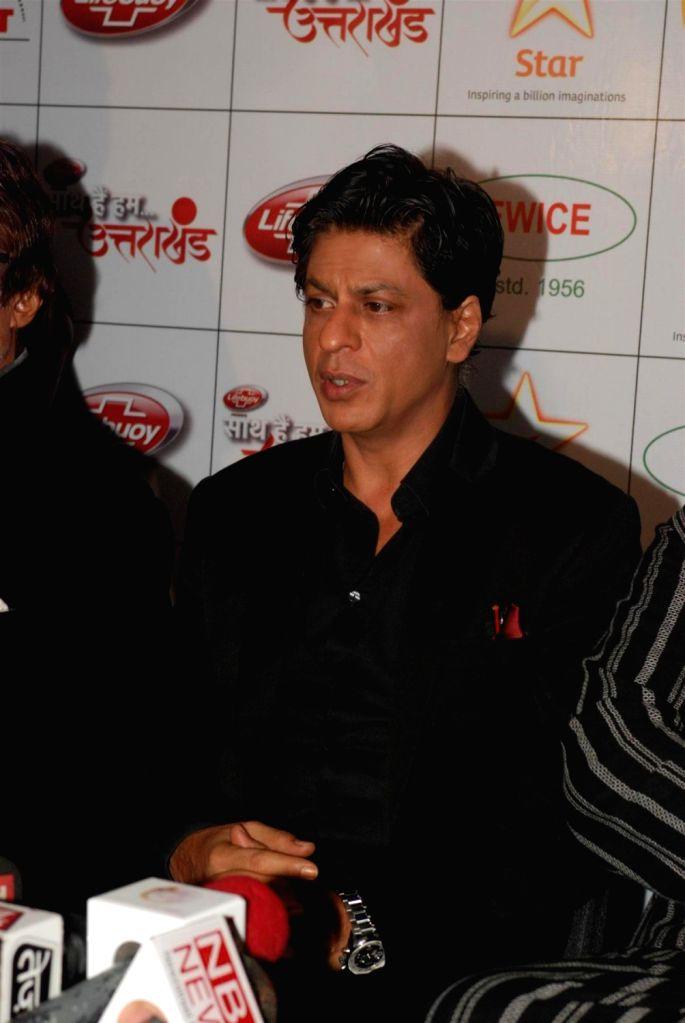 Bollywood actor Shahrukh Khan during the Star India`s `Saath Hain Hum Uttarakhand` 7-hour programme in Mumbai on August 15, 2013. (Photo::: IANS) - Shahrukh Khan
