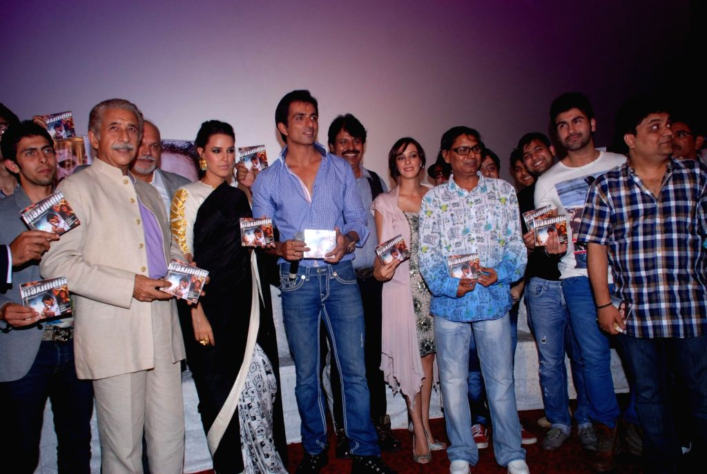 Bollywood actor Sonu Sood and Naseeruddin Shah with Bollywood actress Neha Dhupia and Hazel Keech Maximum film music launch at PVR Mumbai, India. - Sonu Sood, Neha Dhupia and Naseeruddin Shah