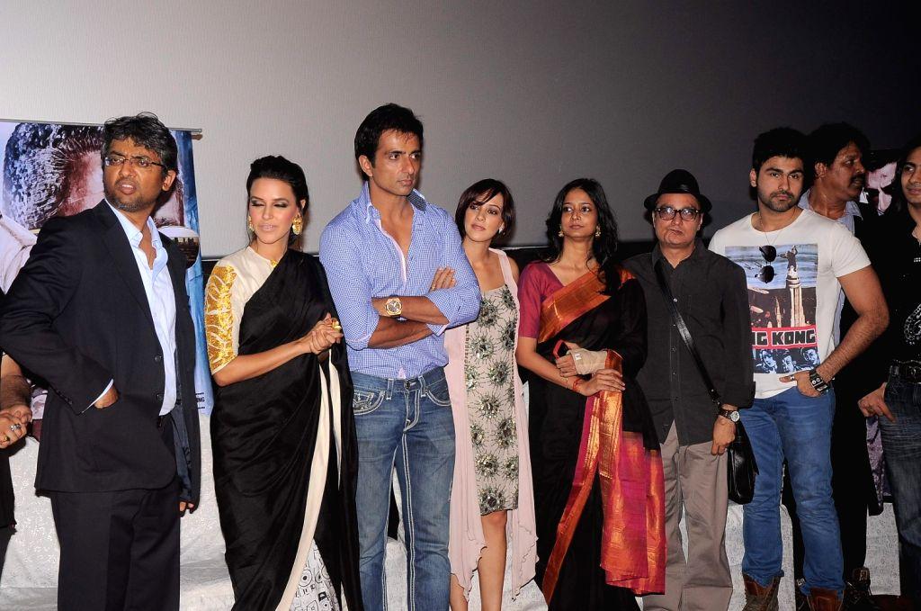 Bollywood actor Sonu Sood with Bollywood actress Neha Dhupia and Hazel Keech Maximum film music launch at PVR Mumbai, India. - Sonu Sood and Neha Dhupia
