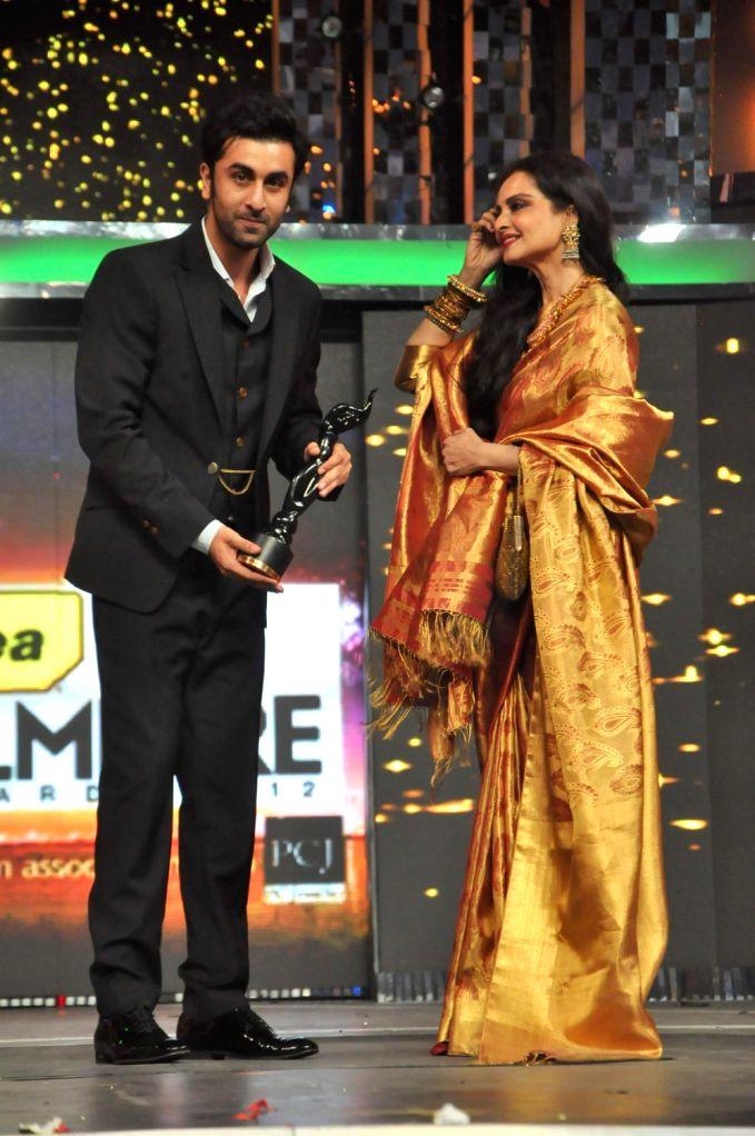 Bollywood actors Ranbir Kapoor and Rekha at the red carpet of The Filmfare Awards 2013 in Mumbai. - Ranbir Kapoor and Rekha