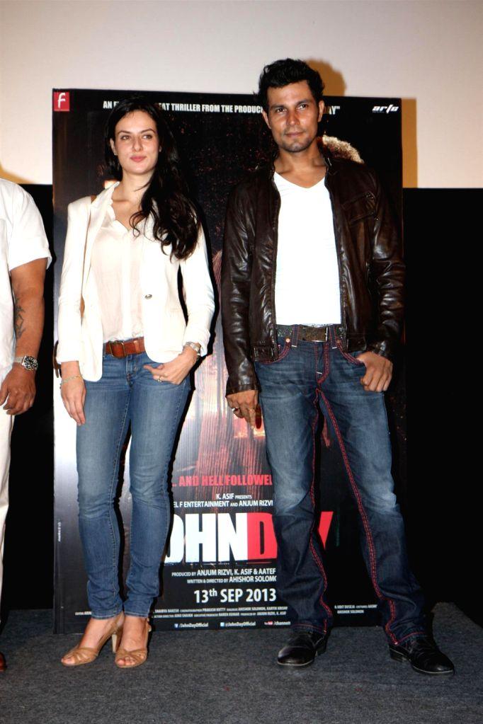Bollywood actors Randeep Hooda and Elena Kazan during the promotion of film John Day in Mumbai on August 14, 2013. (Photo::: IANS) - Randeep Hooda and Elena Kazan