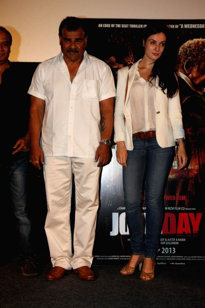 Bollywood actors Sharat Saxena and Elena Kazan during the promotion of film John Day in Mumbai on August 14, 2013. (Photo::: IANS) - Sharat Saxena and Elena Kazan