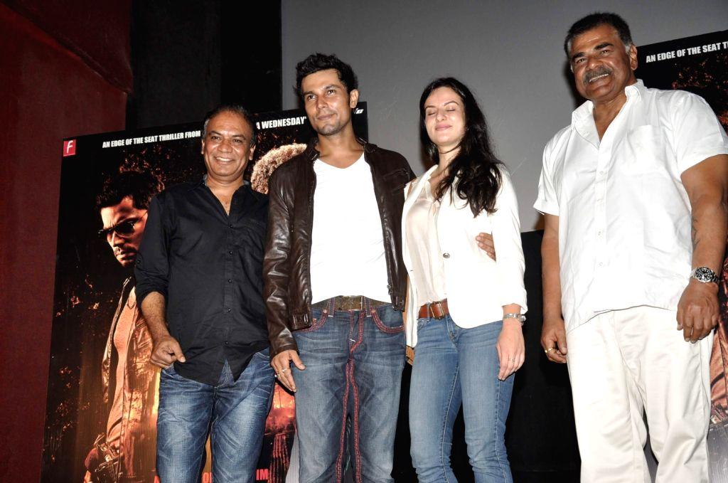 Bollywood actors Vipin Sharma, Randeep Hooda, Elena Kazan and Sharat Saxena during the promotion of film John Day in Mumbai on August 14, 2013. (Photo::: IANS) - Vipin Sharma, Randeep Hooda and Elena Kazan
