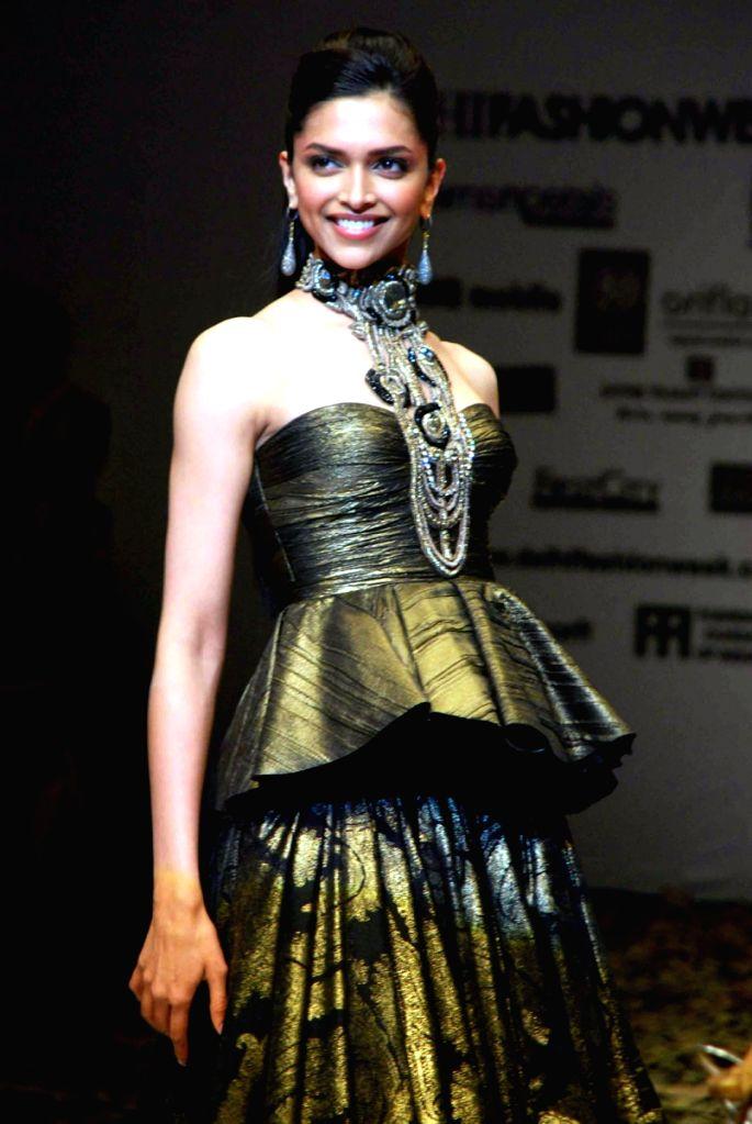Bollywood actress Deepika Padukone on the ramp for designer Tarun Talhiani at Wills Lifestyle India Fashion Week in New Delhi on March 20. - Deepika Padukone