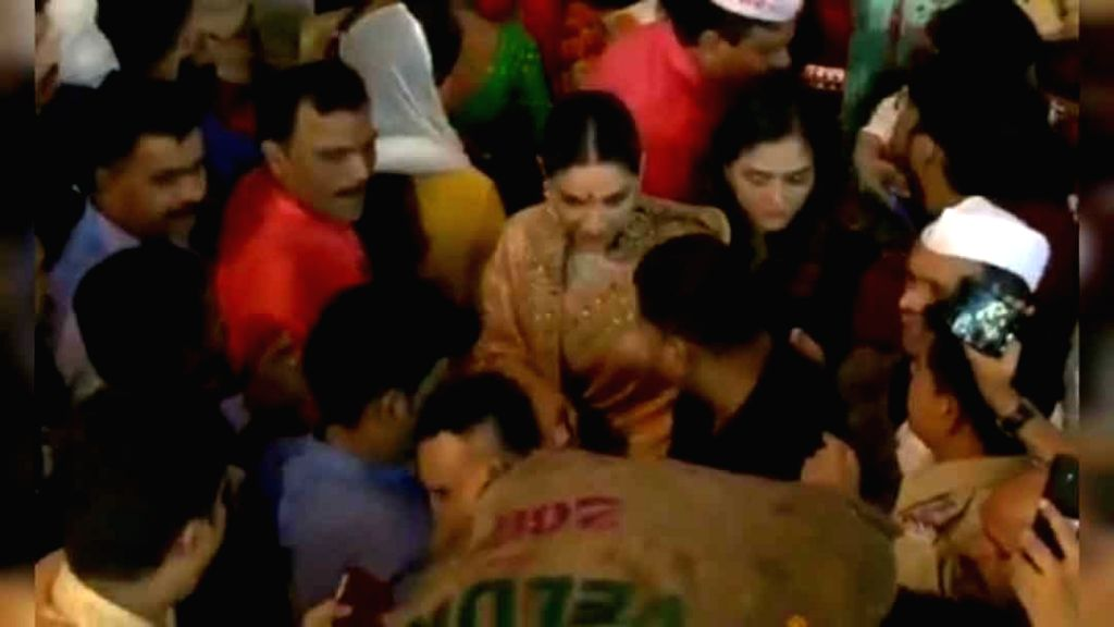 """Bollywood actress Deepika Padukone recently got mobbed at a ganpati pandal. She visited Mumbai's famous Lalbaugcha Raja Ganpati pandal to seek blessings of the God. As soon as the crowd got to know that the """"Piku"""" star was in the pandal, they rushed  - Deepika Padukone"""