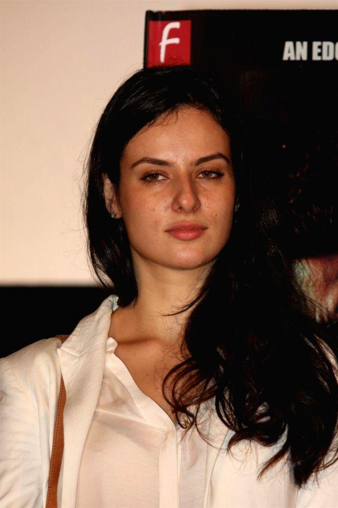 Bollywood actress Elena Kazan during the promotion of film John Day in Mumbai on August 14, 2013. (Photo::: IANS) - Elena Kazan