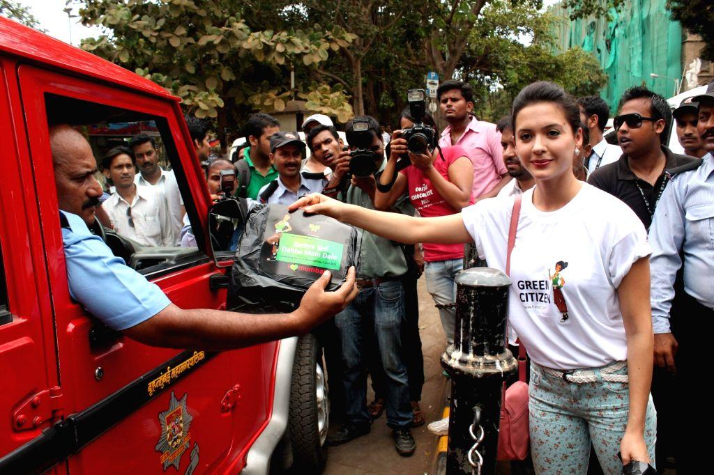 Bollywood actress Isha Sharwani supports the Go Green Initiative at CST in Mumbai.