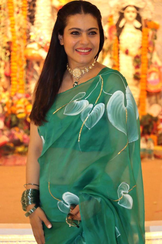 Bollywood Actress Kajol At North Bombay Durga Puja Samiti on the occasion of Maha Navami in Mumbai on Thursday October 14, 2021. - Kajol A