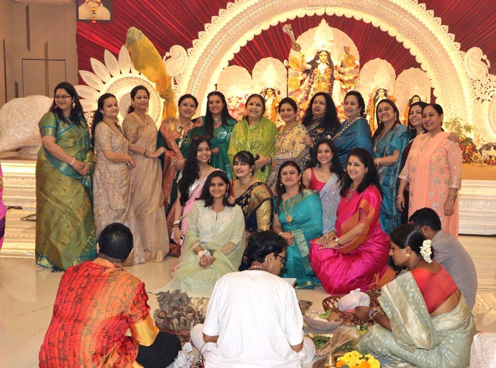 Bollywood Actress Kajol with Family members and Relatives At North Bombay Durga Puja Samiti on the occasion of Maha Navami in Mumbai on Thursday October 14, 2021. - Kajol