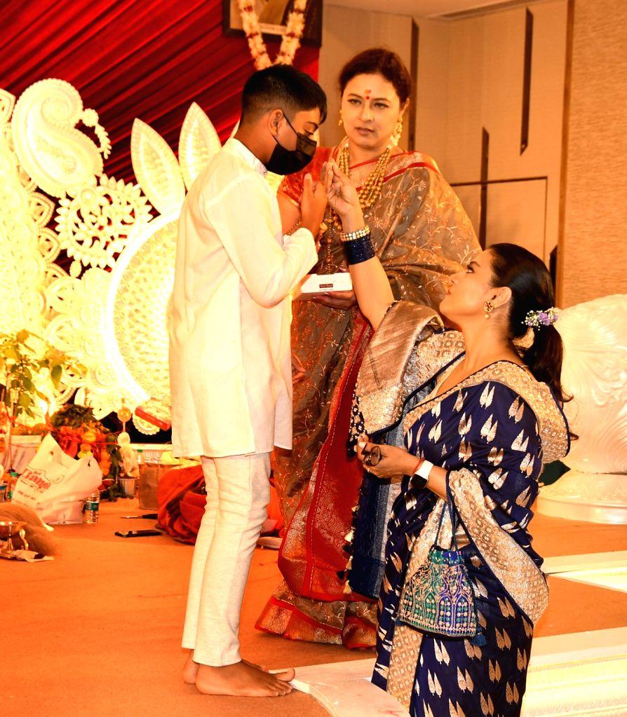 Bollywood Actress Kajol with her son Yug and Rani Mukherjee attents the North Bombay Sarbojanin Durga Puja Samity on the Occasion of Maha Ashtami in Mumbai on Wednesday October 13,2021. - Kajol and Mukherjee